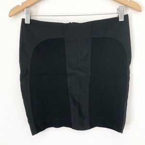 BEBE Black faux leather/ fabric miniskirt size 2